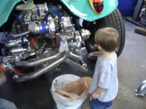 90* carb manifold with polished exhaust and a shop helper!